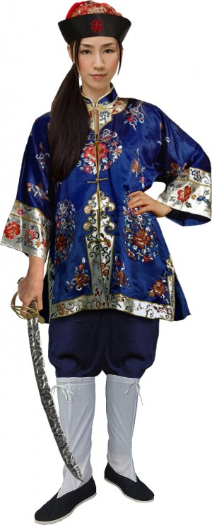 A light-skinned Asian woman in a costume meant to resemble Chinese pirate Ching Shih. She's wearing a red and black embroidered silk hat, a blue, gold and red embroidered silk tunic, blue cotton pants tucked into tall white socks and blue cloth shoes. She holds a cutlass in her right hand.