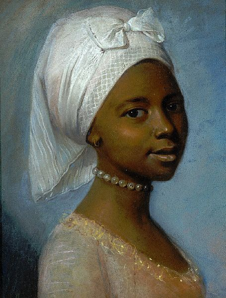 An oil painting of a young black woman in early 19th c. dress. She wears her hair wrapped in white cloth with a bow tied in the front. She has on a pearl choker necklace and you can see the beaded scoopneck of the bodice of her gold dress.