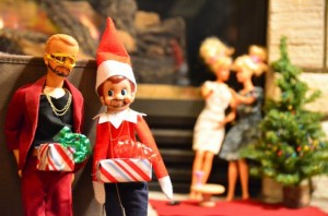 "An ""Elf on the Shelf"" doll and another male doll are dressed up with a present box in front of their crotches, a la the ""Dick in a Box"" SNL sketch."