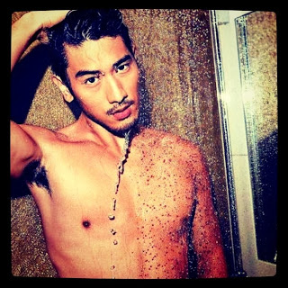 A photo of Taiwanese-Canadian actor Godfrey Gao, shirtless and wet.