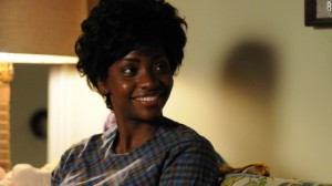 Actress Teyonnah Parris smiles in a still from the tv show Mad Men