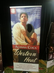 Poster for Alanna Coca's book Western Heat. It's a tall pposter of the book cover with a white hero and a white heroine where there's a hole for a woman to put her face where the heroine's would be.