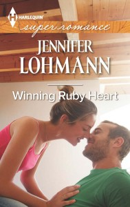 Book cover for Winning Ruby Heart by Jennifer Lohmann. A white woman in a pink camisole tank top and her light brown hair in a bun leans over to kiss a seated white man in a green t-shirt and a stubble beard.