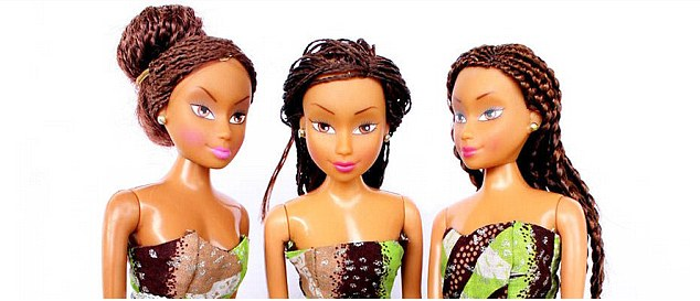 Three vinyl fashion dolls like Barbies have long brown kinky hair, darker skin and wear African print clothing.