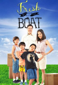 An Asian-American family poses before an impossible green grass and bright blue sky in a standard suburban sitcom positioning