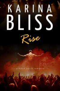 Book cover for Rise by Karina Bliss. A shirtless man is standing on a stage with his arms to the side and his back to the audience.