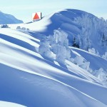 A large snow drift on a snow covered mountain with a photoshopped Citgo sign peeking out from it.