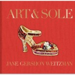 Below a gold title on a full red background a multi colored high heel shoe made entirely of gemstones rests above the author's name.