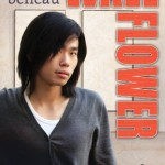 Book cover for Wallflower by Heidi Belleau. A slight Asian man with chin-length black air looks shyly at the camera while wearing a black v-neck cardigan over a white t-shirt.