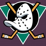 Former logo of the Mighty Ducks of Anaheim. A white hockey goalie mask with a duck bill on top of criss-crossed hockey sticks on a teal triangle against a purple background.