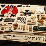 The equipment a British soldier would have carried at Waterloo laid out on a blanket.