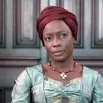 Aminata, a former slave, is shown in fashionable late colonial dress with her hair wrapped in burgundy linen.